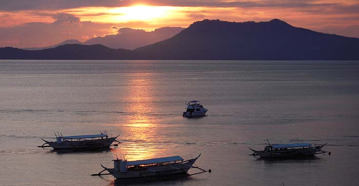 Sunset over Puerto Gallera Bay, Philippines - Photo shot from a Seaview Room at El Galleon Resort - copyright Ken Knezick, Island Dreams