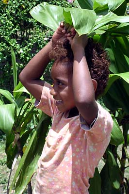 Fijian Girl at a Mango Stand